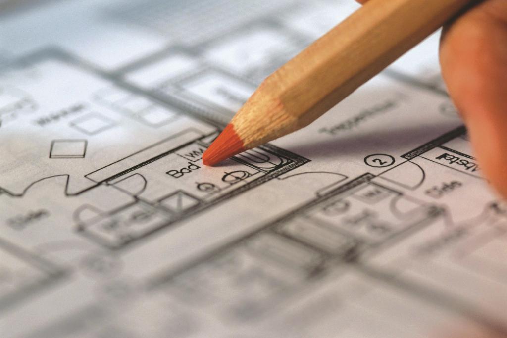 Grundrisszeichnung vom Eigenheim, Bleistift zeigt aufs Bad