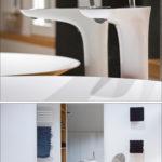 Waschbecken und Armaturen bei Badgestaltung auf einem Badezimmerschrank aus Holz