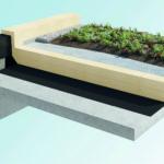 Flachdach: das ebene Dach mit Stil. Bepflanzt mit grünen Pflanzen.