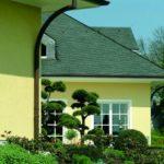 Die Fassade eines Hauses gestaltet durch Edelkratzputz